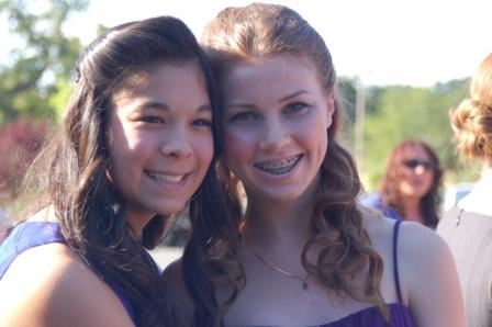 Two girls in formal wear smiling together Best Friends