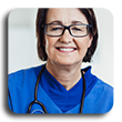 Smiling female medical professional with stehoscope around neck