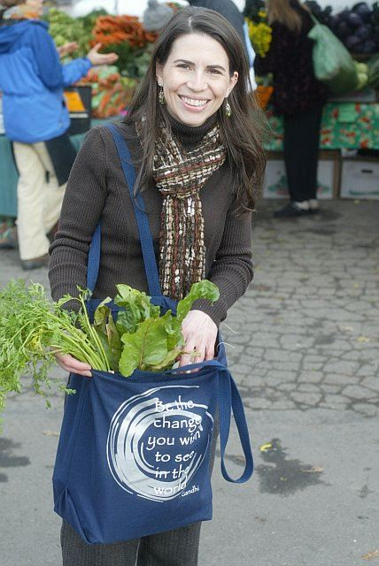 Julie Dehollander Holding Bag of Greens