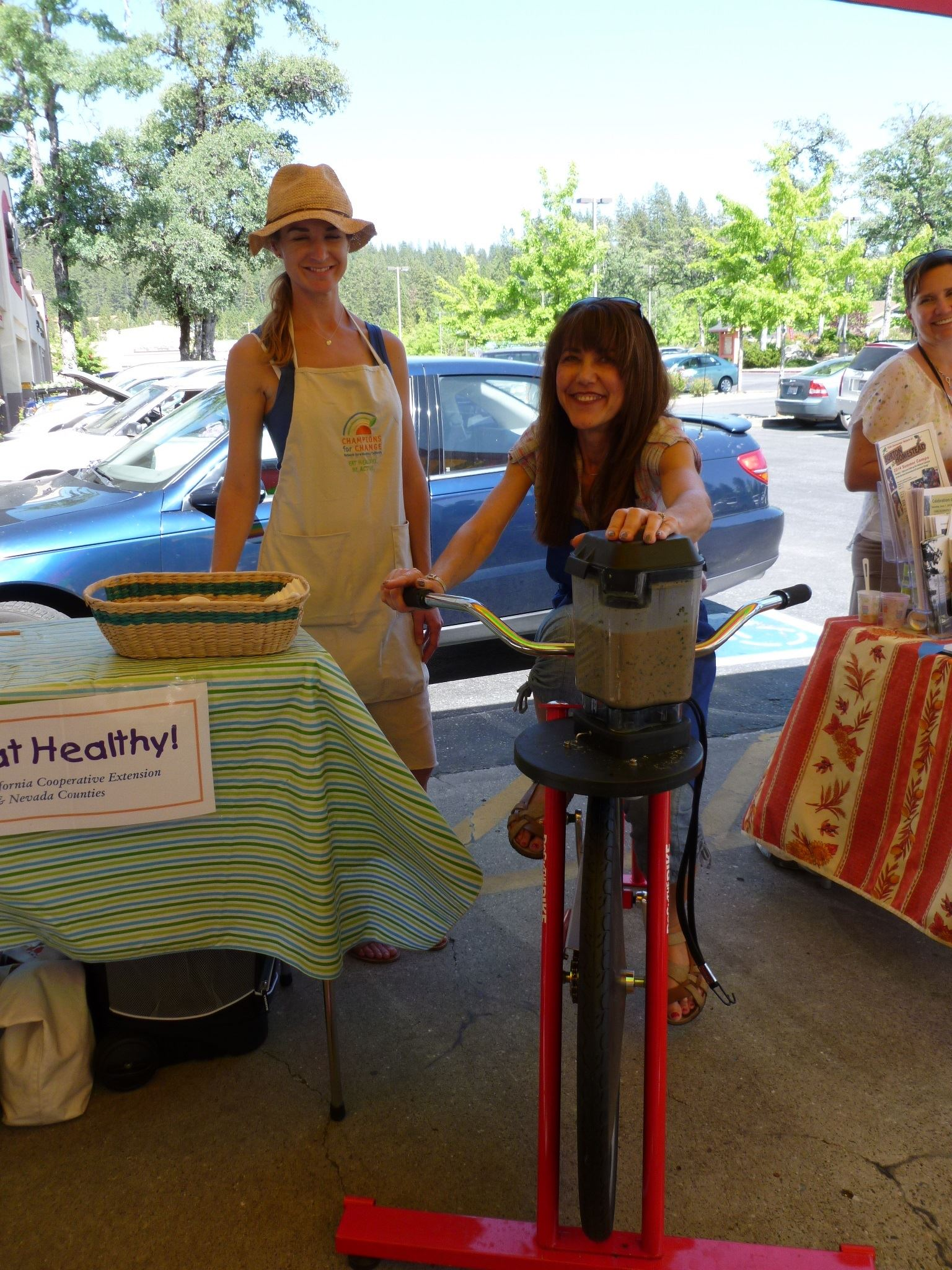 Woman on stationary bike peddling to create a smoothie