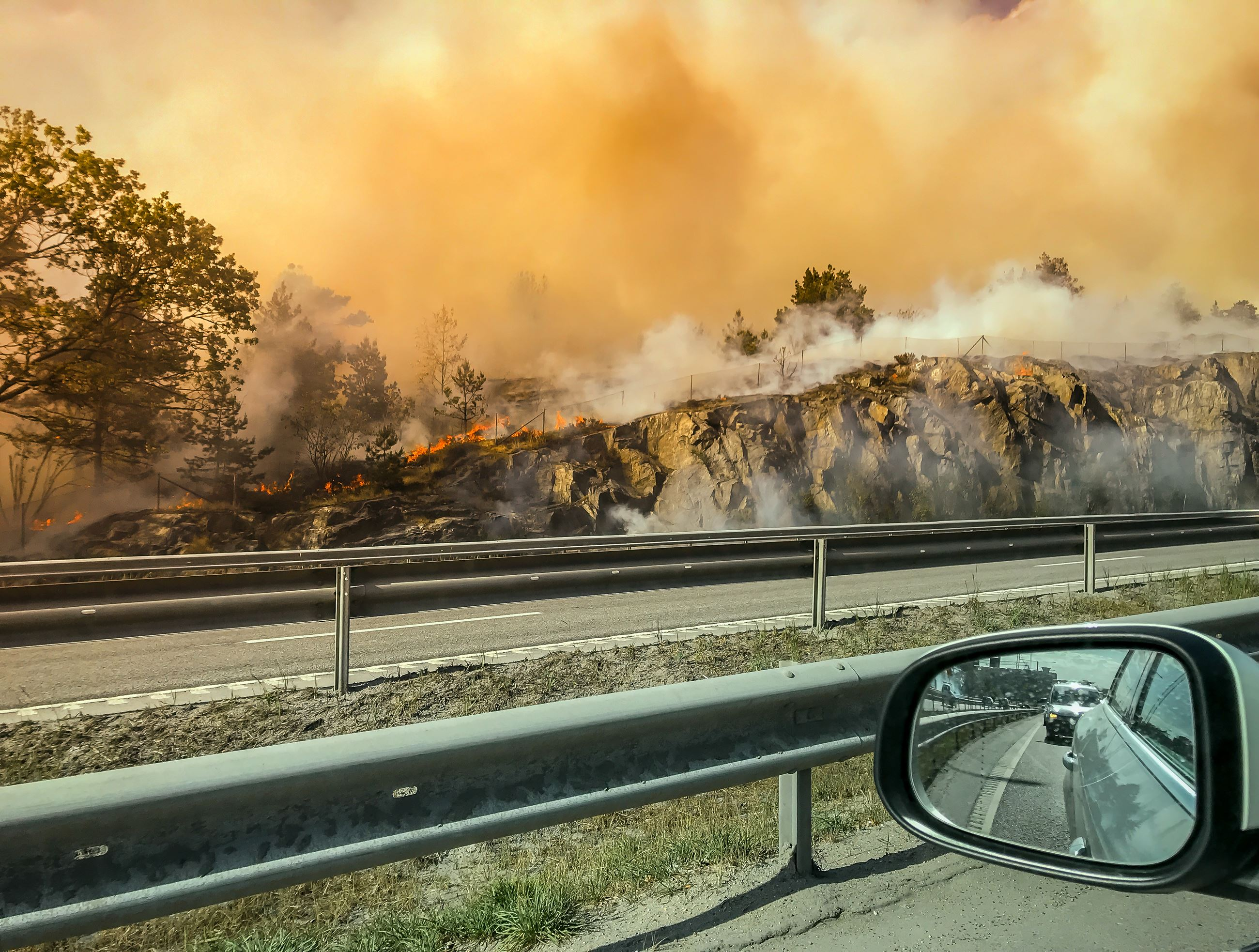 Forest-fire-near-road-or-hightway-seen-from-car.-978462692_4000x3024